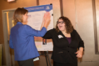 Colleen Kristich, MSW '18, and Cheyenne Ketter-Franklin, BS '17, MBA '18, celebrate winning on behalf of the Social Impact Fellows program.