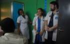 Nursing students Aba-Fynn-Aikins, center, and Seth Wagner, right, visited each unit in Donkorkrom Hospital in rural Ghana to learn and assist patients. Photo: Jordi Owusu