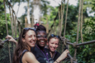 From left, UB School of Management PhD candidate Emily Campion, Claudia Ludmila Blankson of Ghana, and UB MD/MBA student Claire Cowden stand on a canopy walkway high above Kakum National Park. Photo: Anthony Falvo