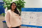 Khadija Ajmal, one of the poster competition winners, shows off her research on plastic recycling.
