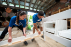 At the Service Collaborative, a team of Social Impact Fellows developed a plan to sustain its Beds for Buffalo initiative—and got their hands dirty helping the nonprofit construct beds too. Photo: Onion Studio.