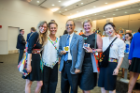 The winner of the Pitch for a Cause competition was the Stitch Buffalo team. From left, Kristie Bailey, MSW student; Dawne Hoeg, founder and director of Stitch Buffalo; Satish K. Tripathi, UB president; Shannon Lach, MBA student; and Xingyu Chen, doctoral student in global gender studies, show off a few of Stitch Buffalo's products. Photo: Onion Studio.