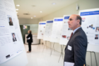 Competition judge Michael Weiner, MBA '90, reviews the fellows' posters during the Pitch for a Cause.