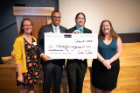From left, Maggie Saia, safety director at Oneida Sales and Service; Ezra Staley, executive director of social innovation at UB; and Aric Gaughan and Alyssa Bergsten, UB Social Impact Fellows, celebrate the fellows' win for their construction worker safety program.