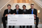 UB MBAs Patrick Biver, Briar Baker, Ronald Mendoza and Alex Lesins celebrate their first-place finish in the inaugural UB MBA Case Competition.