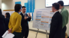 At center, Wesley Mark and his teammates presented their research on predicting stock or cryptocurrency movements to make better purchases.