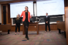 Alex Mcleod presents with her team at the Whitman Case Competition