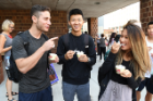 "From left: Senior accounting majors Brennan Shoykhet, Patrick Wong and Jia Wu take an ice cream break. ""True to the Blue"" is ""amazing,"" says Wu, between spoonfuls."