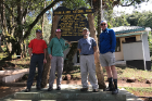UB-affiliated mountain climbers (from left) Jim Eaton, Bill Sullivan, John Sexton and Scott Weber pose for a picture at the Machame Gate, the starting point for many treks up Mount Kilimanjaro.