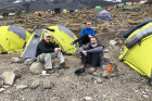 From left: John Sexton, Scott Weber and John Reese sit near their tents at Karanga Camp, elevation 13,000 feet.