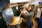 Nick Cappello stirs a vat of grain used to make the high-test alcohol.