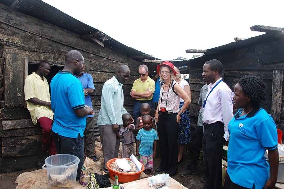 Photo of McGlynn with community members in Africa.