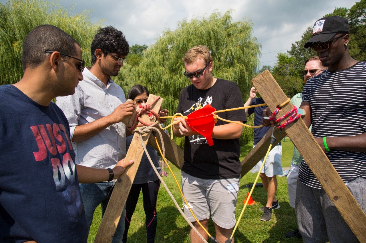 In one activity, MBA students worked with their teams to successfully build a catapult.