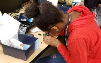 Student assembles a Raspberry Pi computer in GenCyber camp. Read about startups in this issue of Buffalo Business.