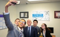 Gregg Fisher takes a selfie with students in the Fisher Research Collaborative. Read his profile in this issue of Buffalo Business.