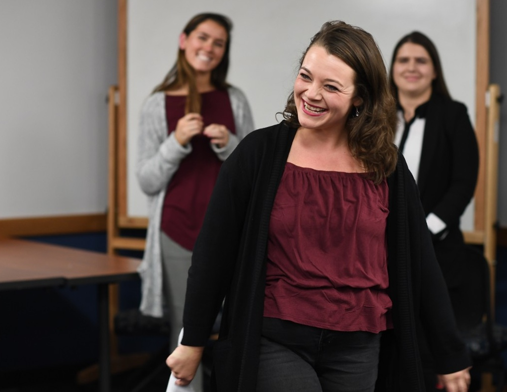 Celine Keefe smiles while leading an improv workshop for Women in Management club members.