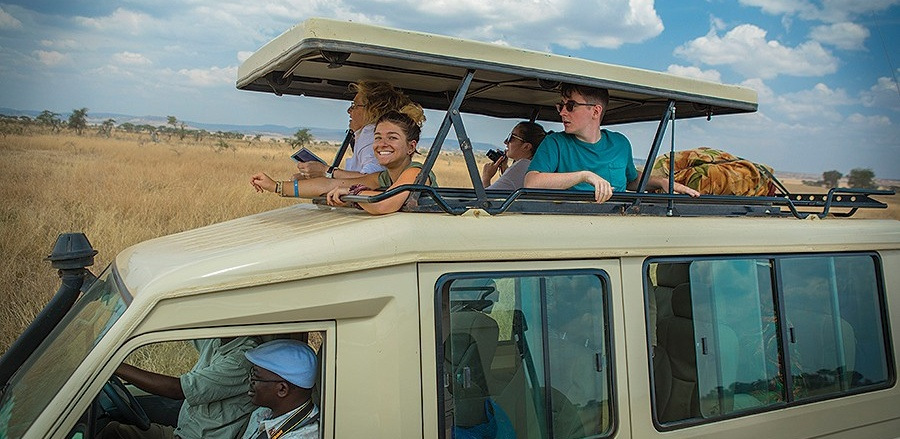 A truck carries students and faculty through Serengeti National Park in Tanzania.
