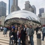 Students standing in front of the Bean sculpture in Chicago.