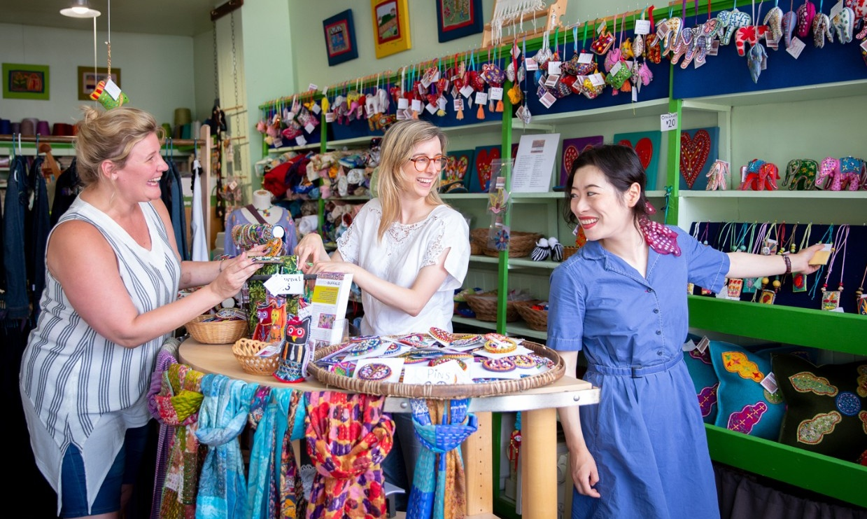 Shannon Lach, Kristie Bailey and Xingyu Chen work at Stitch Buffalo.