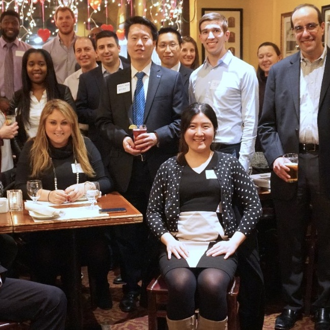 School of Management staff and alumni at a dinner in a restaurant New York City.