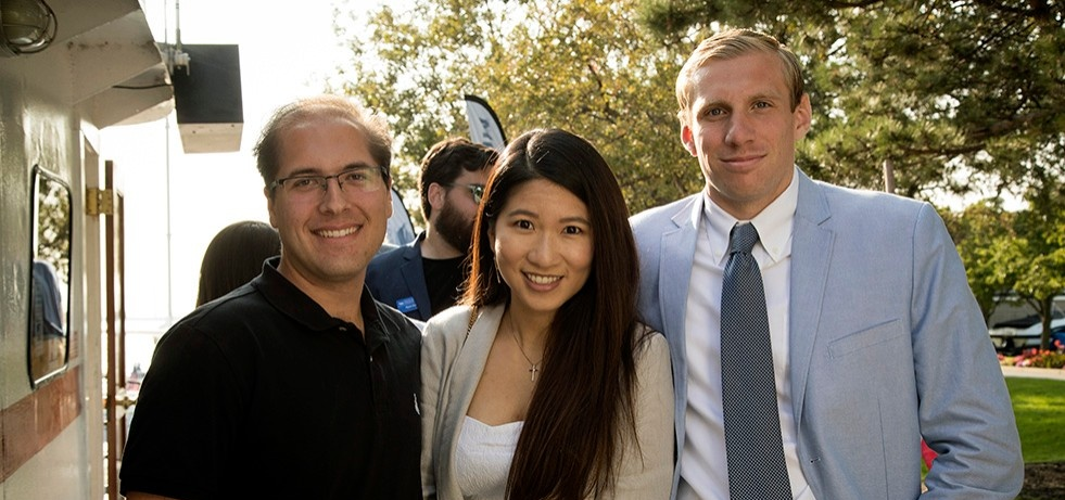 Three MBA students at an Advantage event.