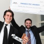 Two 2018 Panasci winners holding up an oversize check