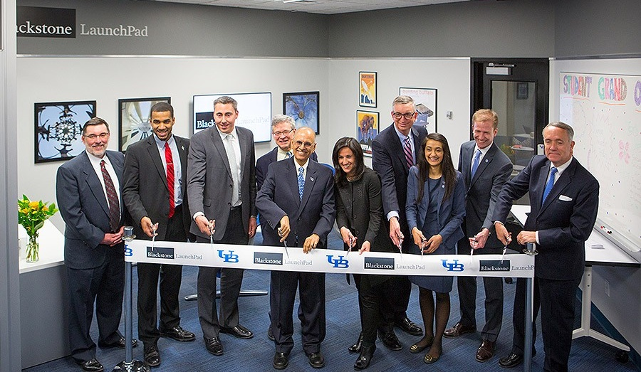 President Tripathi joins Blackstone Foundation leadership and UB faculty and staff for the ribbon cutting ceremony at the grand opening.