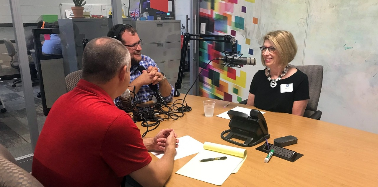 Shelley Drake talks with Nate Benson and Darren Treadway in the studio