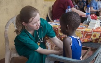 UB student treats a local child at a clinic.