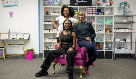 Tamara Lewis-Cunningham, MWEE '07, Zandra Cunningham, MWEE '14 and Zandra Lewis, MWEE '07, in the showroom of their Pierce Arrow Commerce Park production facility.