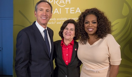School of Management alumna Judy Vredenburgh, MBA '75, with Starbucks CEO Howard Schultz and media mogul Oprah Winfrey.
