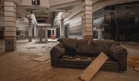 Couch in vacant retail space.