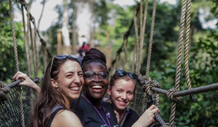 From left, UB School of Management PhD candidate Emily Campion, Claudia Ludmila Blankson of Ghana, and UB MD/MBA student Claire Cowden stand on a canopy walkway high above Kakum National Park.