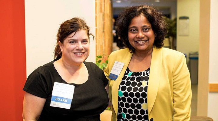 Two female alumni at an event.