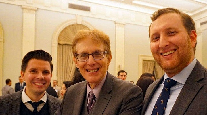Three male Alumni smiling at an event.