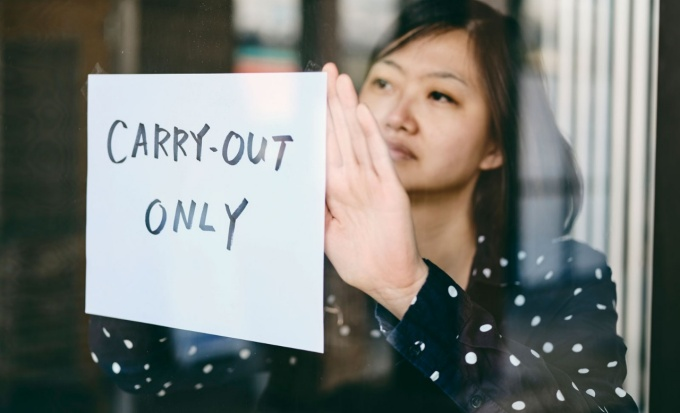 "Entrepreneur displays a ""Carry-out only"" sign."