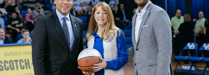 Donald Reed, UB senior associate athletic director, Muriel Anderson, clinical associate professor in the UB School of Management, and Jason Bird, MetLife advisor and title sponsor.