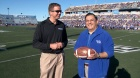 Danny White, UB director of athletics with Arjang Assad, dean of the University at Buffalo School of Management
