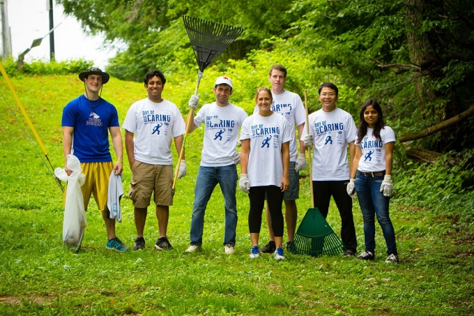 Several School of Management students pose for a photo in University Heights during the United Way Day of Caring.