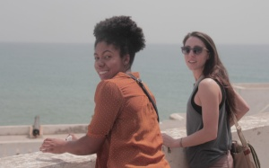 MBA student Danielle Vazquez and PhD student Emily Campion look out at the ocean from Cape Coast Castle in southern Ghana.