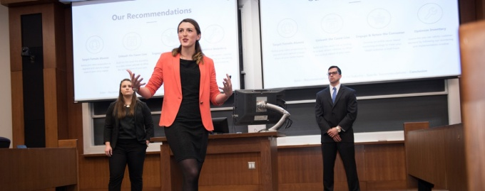 MBA students present at a case competition.