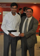 Srikanth Parameswaran with Arjang Assad, dean of the School of Management.