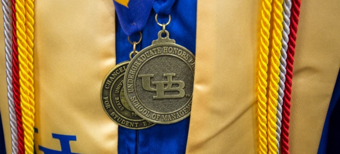 An honors medal photographed at a commencement ceremony