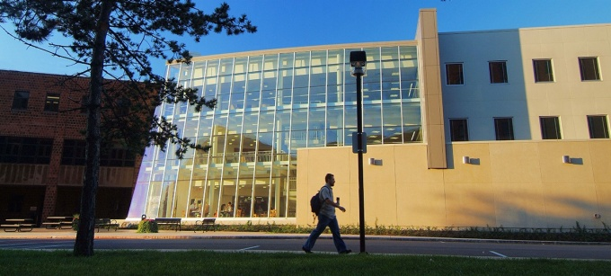 Student walking outside Alfiero Center.