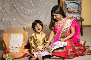 Babaria reading to her son, who is smiling at the camera.