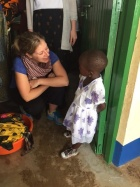 Alison Balind, then a MSW student from Canada, speaks with a local student during a trip to Tanzania in January 2016.